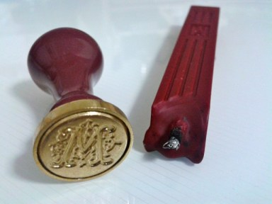 Nice brass seal with nice sealing wax with a wick!