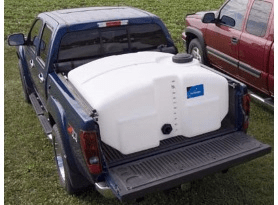 A blue pickup truck is holding a large white plastic water container in the truck bed