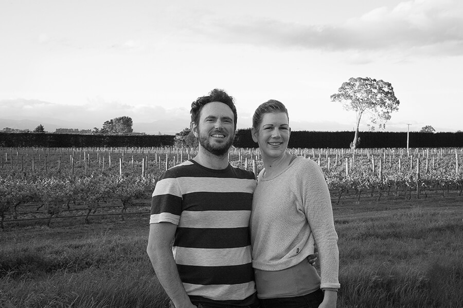 Braden and Gabrielle Crosby standing in-front of their vineyard
