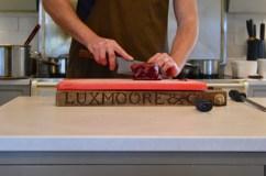 The hands of Gill Meller as he prepares venison tartare.