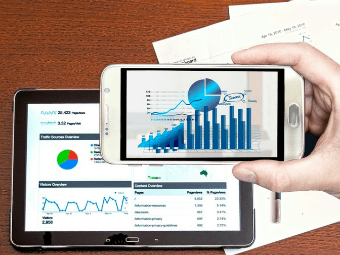 marketing ROI reports on tablet and mobile
