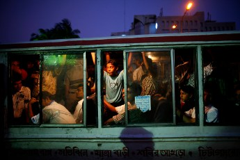 Hazard inside bus -  Passengers standing inside a running bus