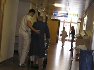 nurse assisting aged patient