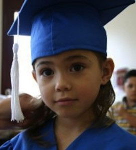 young child graduating
