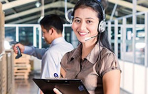 woman with headset and clippoard