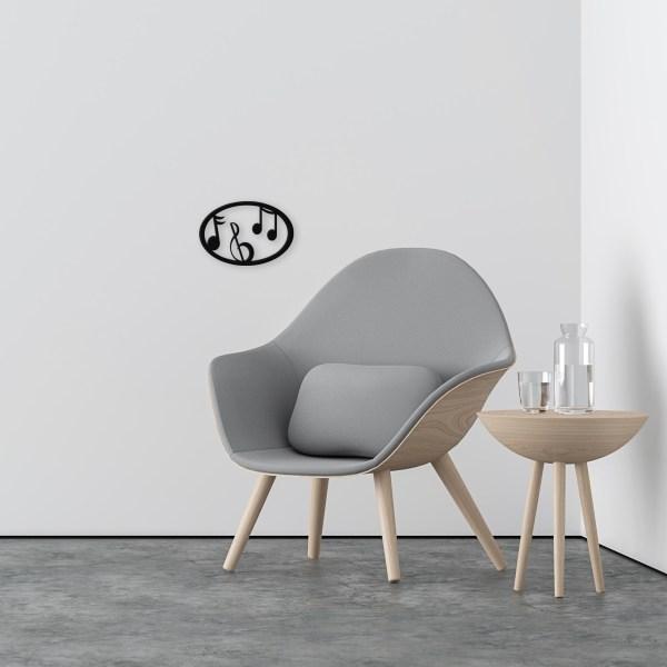 Black-music-oval-near-chair