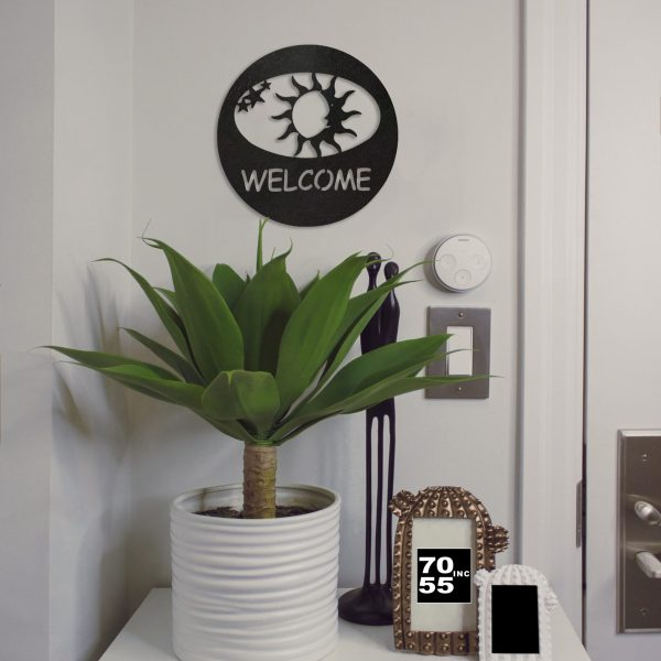 black-sun-welcome-circle-by-door-scaled
