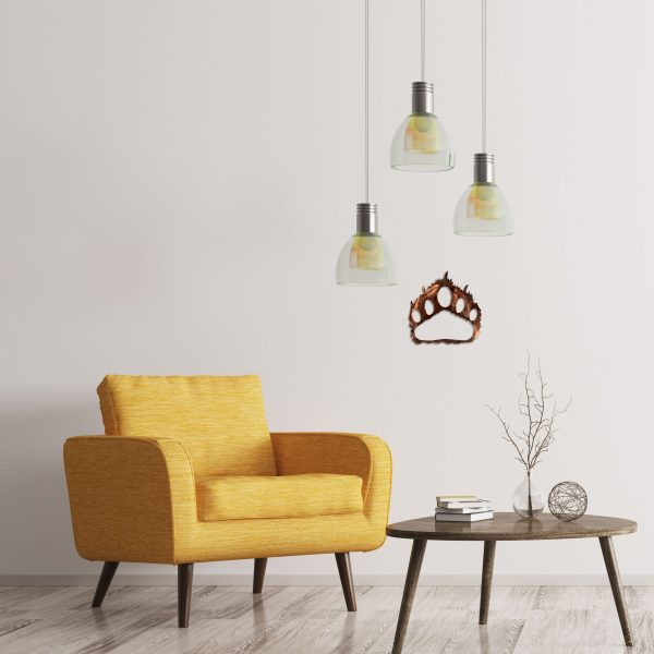 distressed-copper-bear-paw-near-yellow-chair-scaled