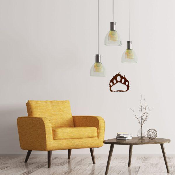 rust-bear-paw-near-yellow-chair-scaled