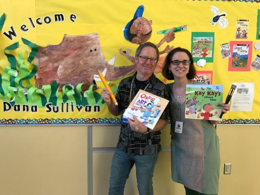 Dana and Horace Mann librarian, Shannon Leonard, with the poster she painted