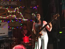 """A vocalist and bass player hits a high note in the song Cake by the Ocean. Her band's performance was especially unique, combing the stylings of Bruno Mars, Justin Timberlake, and Earth Wind & Fire. """"I loved her, she was so into that,"""" said CJI student Grace Butler about the band."""