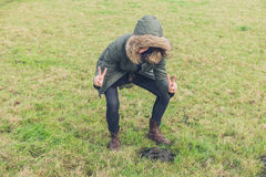 silly-hipster-posing-poo-young-person-field-some-magnificent-looking-cow-dung-63078059