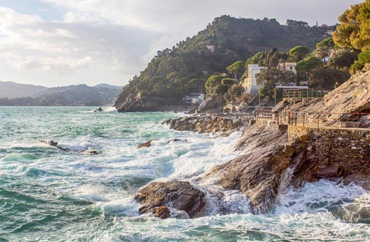 Sea motion on rocks/ Zoagli, Genoa, Italy/ rough sea/sky/ clouds