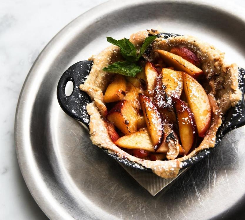Fruit tart in a small, cast iron skillet.