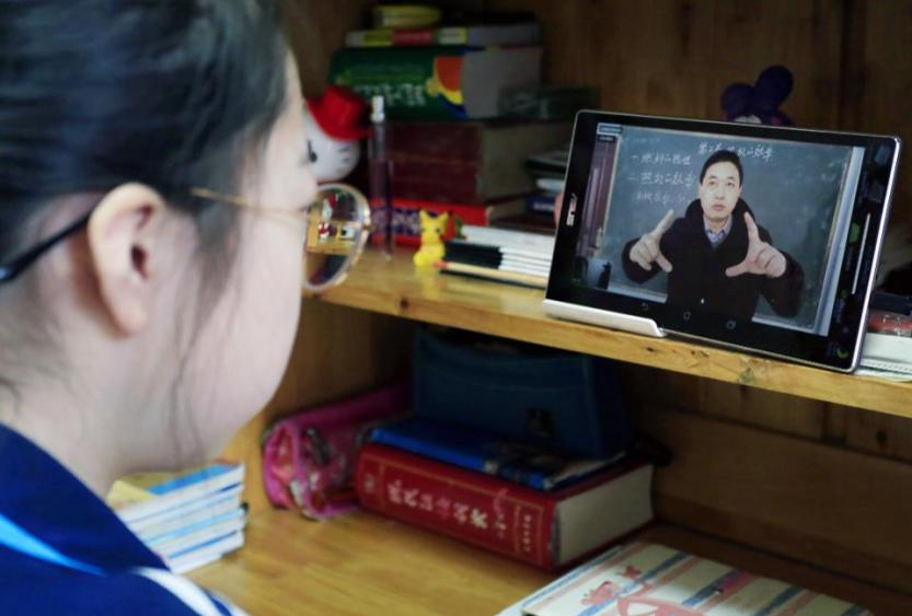 A teacher is teaching students by using multi-media network education system  because of the novel coronavirus pneumonia in Yuncheng,Shanxi,China on 09th February, 2020