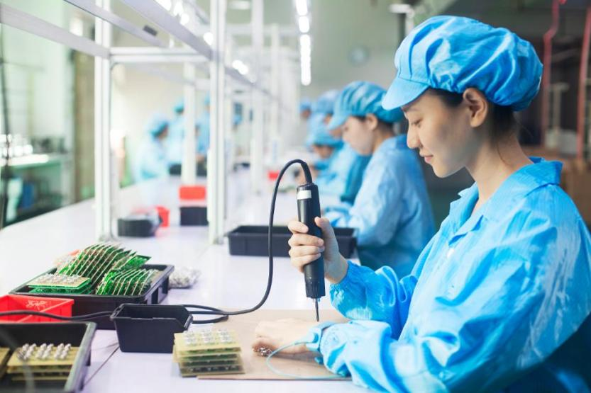 Workers in uniforms at a LED lighting factory in Dongguan, China