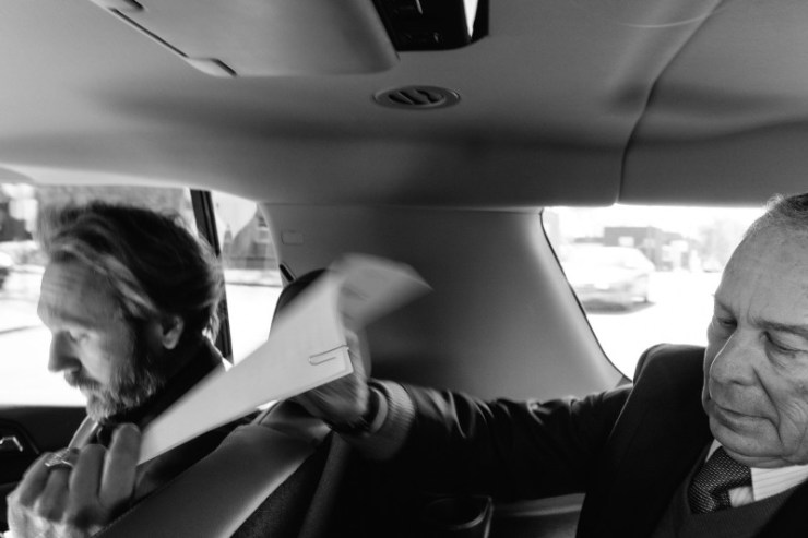 Bloomberg reviews a speech while driving to catch a flight in Memphis on Feb. 28.
