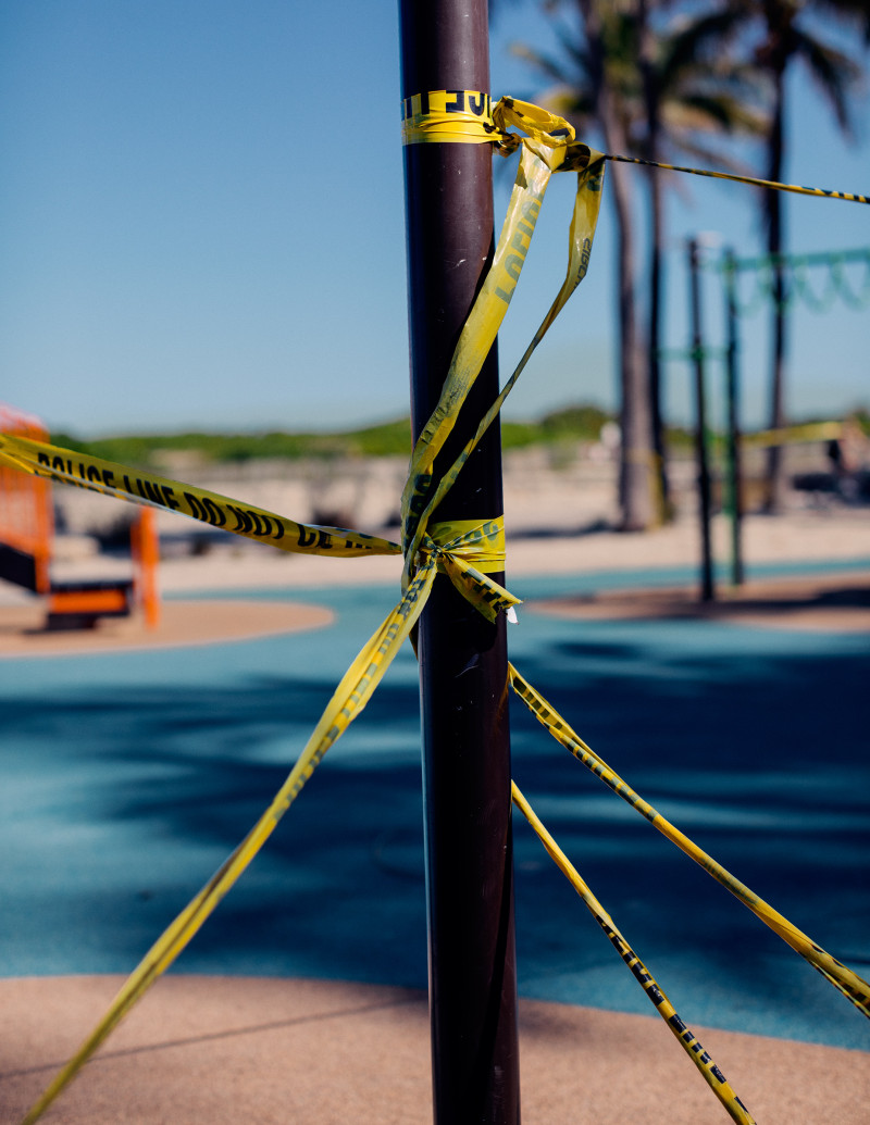 A playground in front of the temporarily closed Betsy Hotel is covered in caution tape as parks remain closed in Miami Beach.