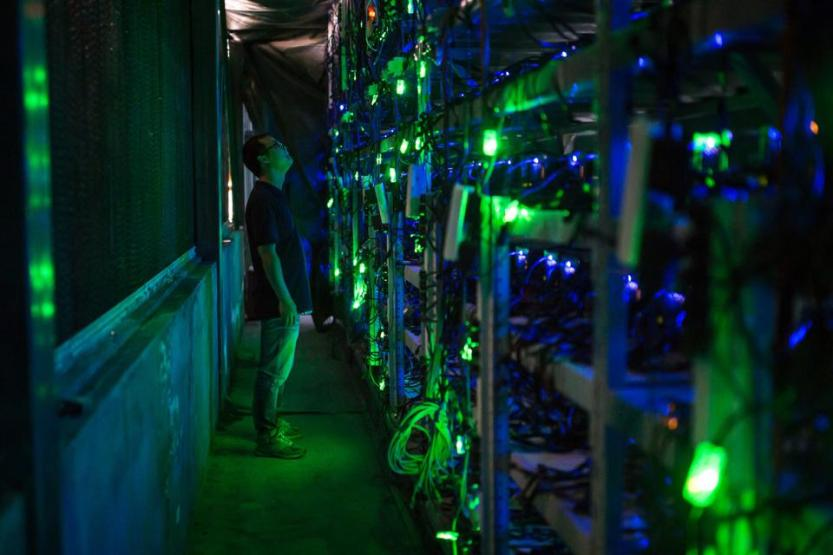 A Bitcoin mining manager checks equipment at a Chinese bitcoin mine in Sichuan.