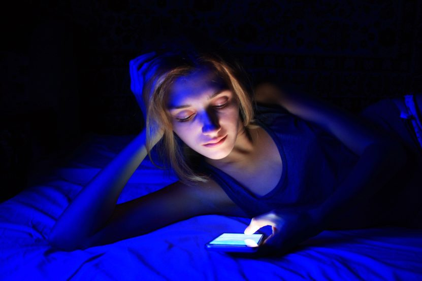 a woman on her phone late at night
