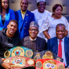 Anthony Joshua presents his heavyweight title to President Buhari in London