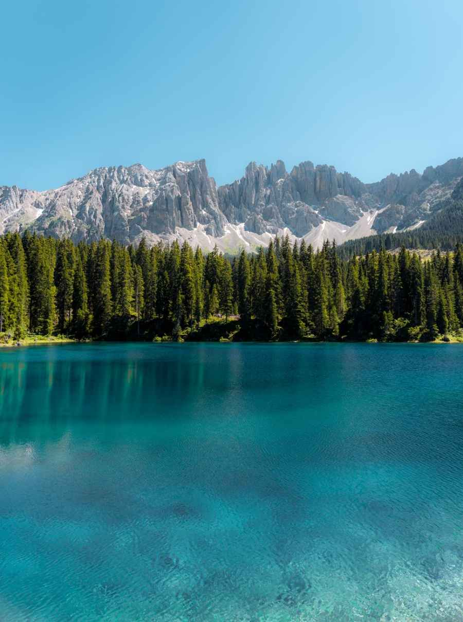 a breathtaking view of the latemar mountain range from lake carezza