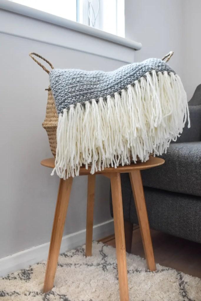 Crochet blanket in basket