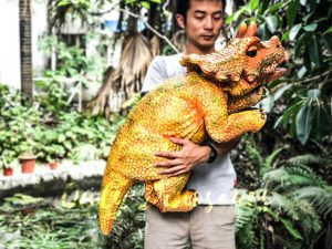 Vivid Baby Triceratops Dinosaur Puppet Orange