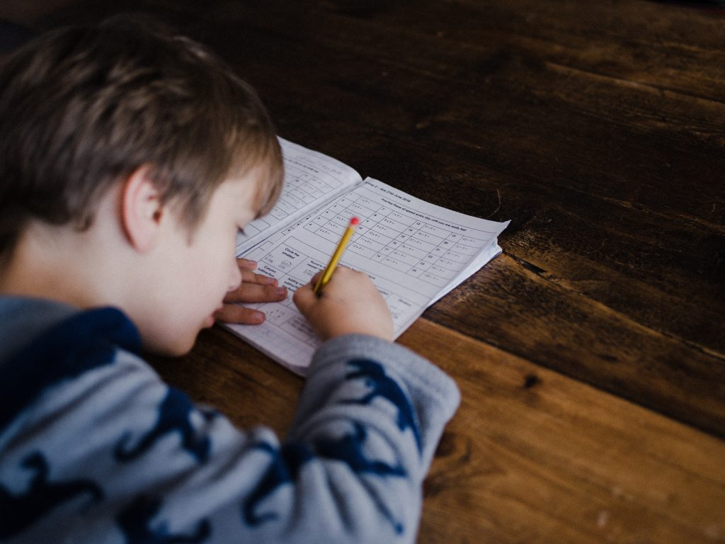 kid learning on his own, practicing autonomy