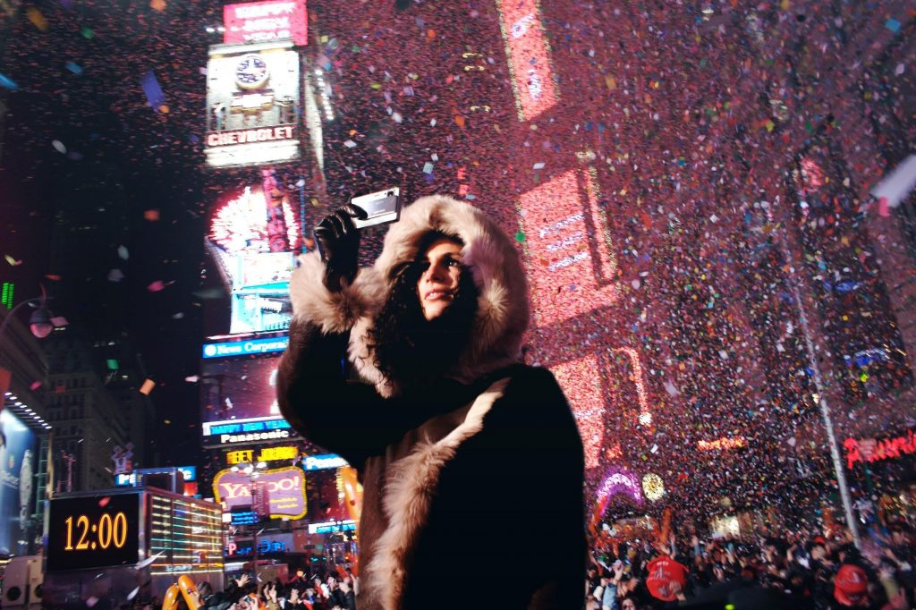 new-years-eve-tradition-man-taking-a-picture-of-the-new-years-eve-ball-at-Times-Square