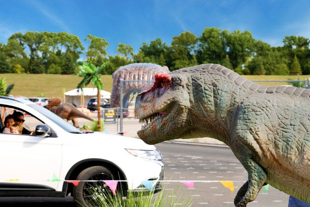 10-Immersive-Dinosaur-Adventures-That-Your-Kids-Will-Never-Forget-A-T-Rex-is-Looking-at-the-Car