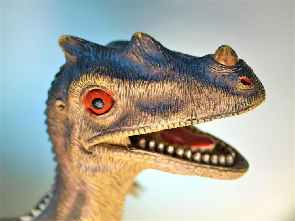 dinosaur-comics-headshot-of-an-open-mouthed-raptor