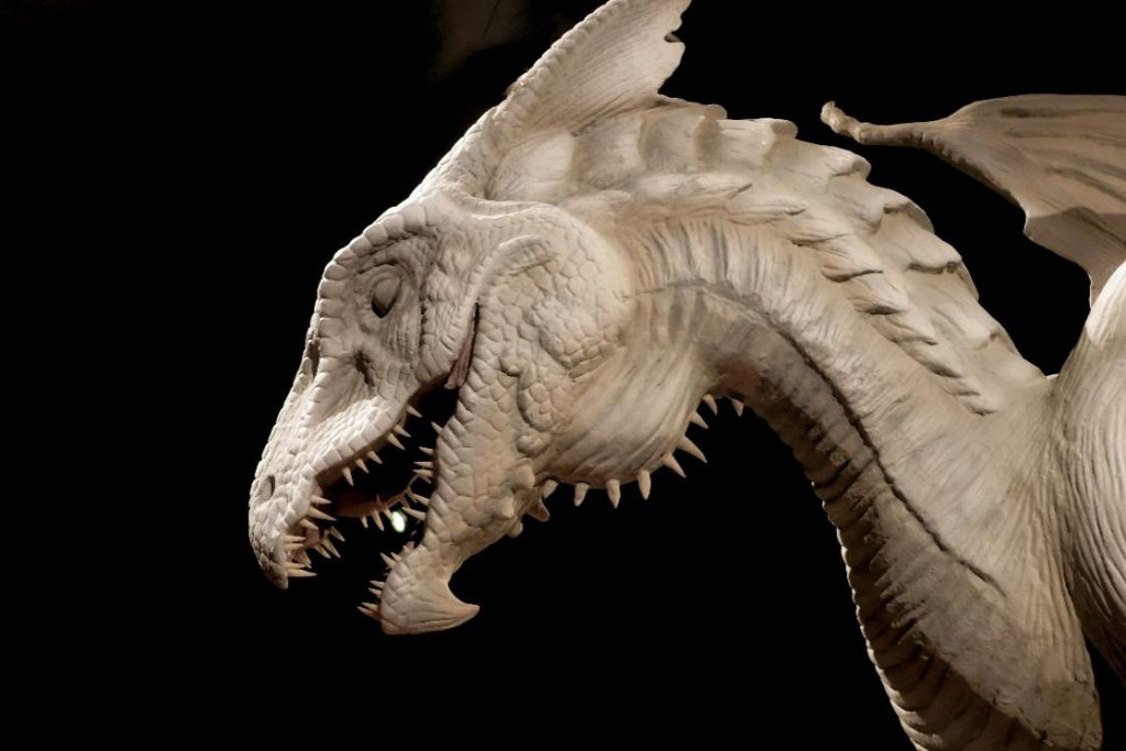 dragon-facts-–-a-gray-animatronic-dragon-facing-the-left-with-a-black-background