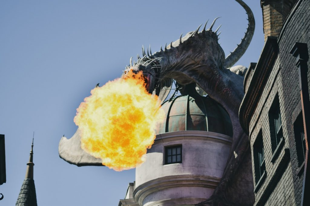dragon-facts-–-a-gray-dragon-breathing-fire-at-Universal-Studios