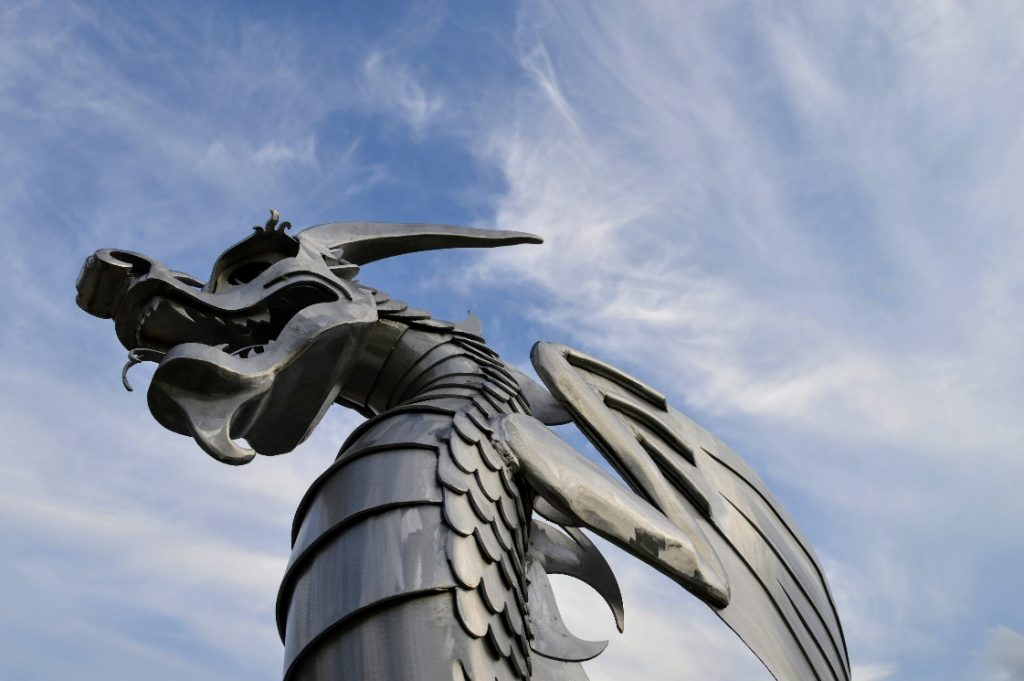 dragon-facts-a-gray-dragon-with-wings-underneath-the-sky