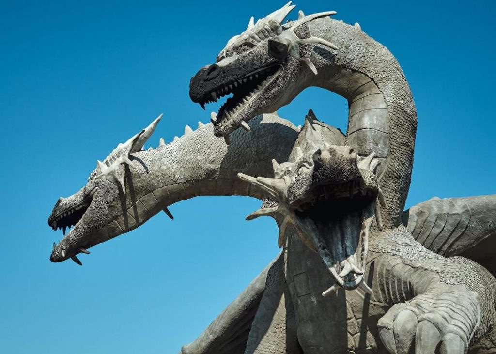 dragon-facts-a-roaring-three-headed-gray-western-dragon-in-a-blue-background