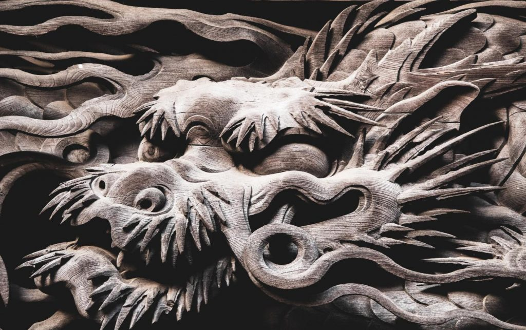 dragon-facts-a-wooden-gray-dragon-with-piercing-looks
