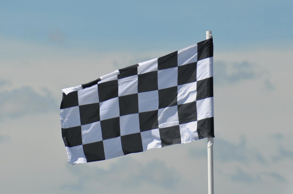 electric-rides-for-kids-a-black-and-white-checkered-flag-waving-in-the-air