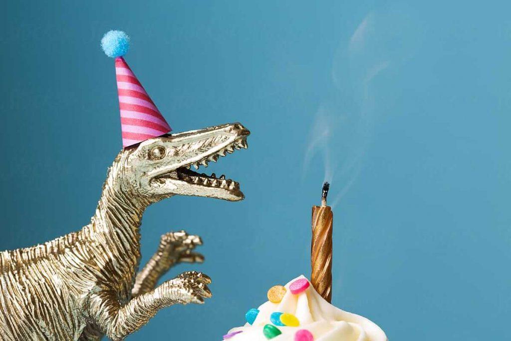 Birthday-cake-and-toy-dinosaur-by-Ruth-Black-Birthday-Birthday-cake-Stocksy-United.jpeg