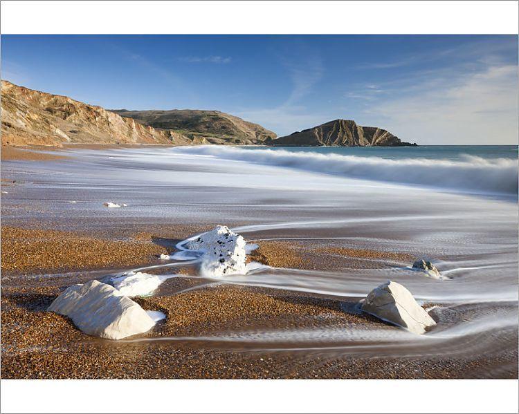 Photograph_-Waves-wash-clean-the-beautiful-beach-at-Worbarrow-Bay-on-the-Jurassic-Coast-Dorset
