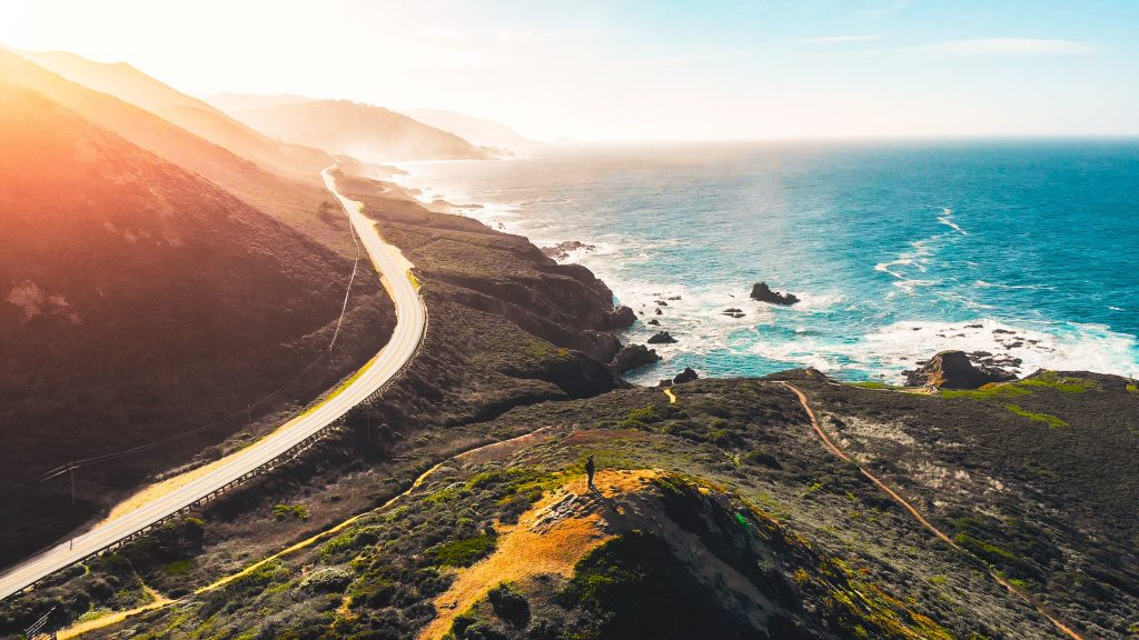 18-Best-Places-to-Travel-in-July-Destinations-in-the-U.S.-Highway-Beside-the-Ocean