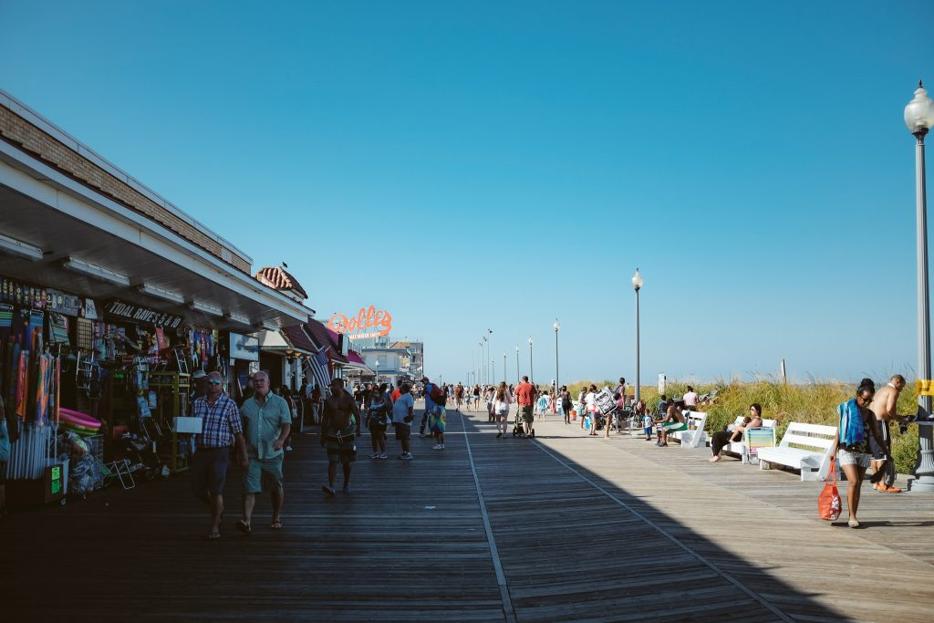 18-Best-Places-to-Travel-in-July-Destinations-in-the-U.S.-People-Walking-on-the-Boardwalk
