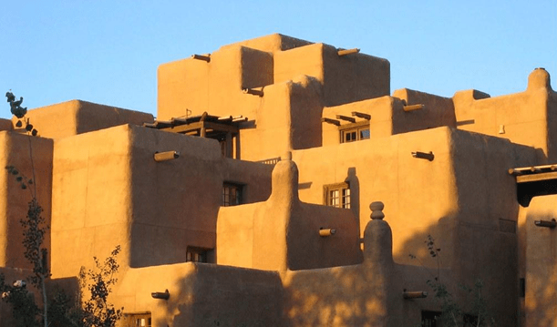 18-Best-Places-to-Travel-in-July-Destinations-in-the-U.S.-Spanish-Pueblo-Style-Buildings