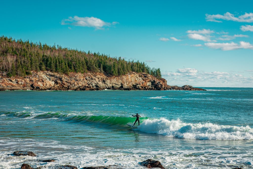 18-Best-Places-to-Travel-in-July-Destinations-in-the-U.S.-Surfing-Man
