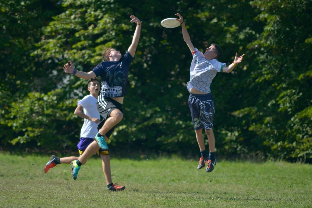18-Fun-Workouts-to-Get-You-Unstuck-Motivated-in-Life-Three-Men-Playing-Frisbee-in-the-Field