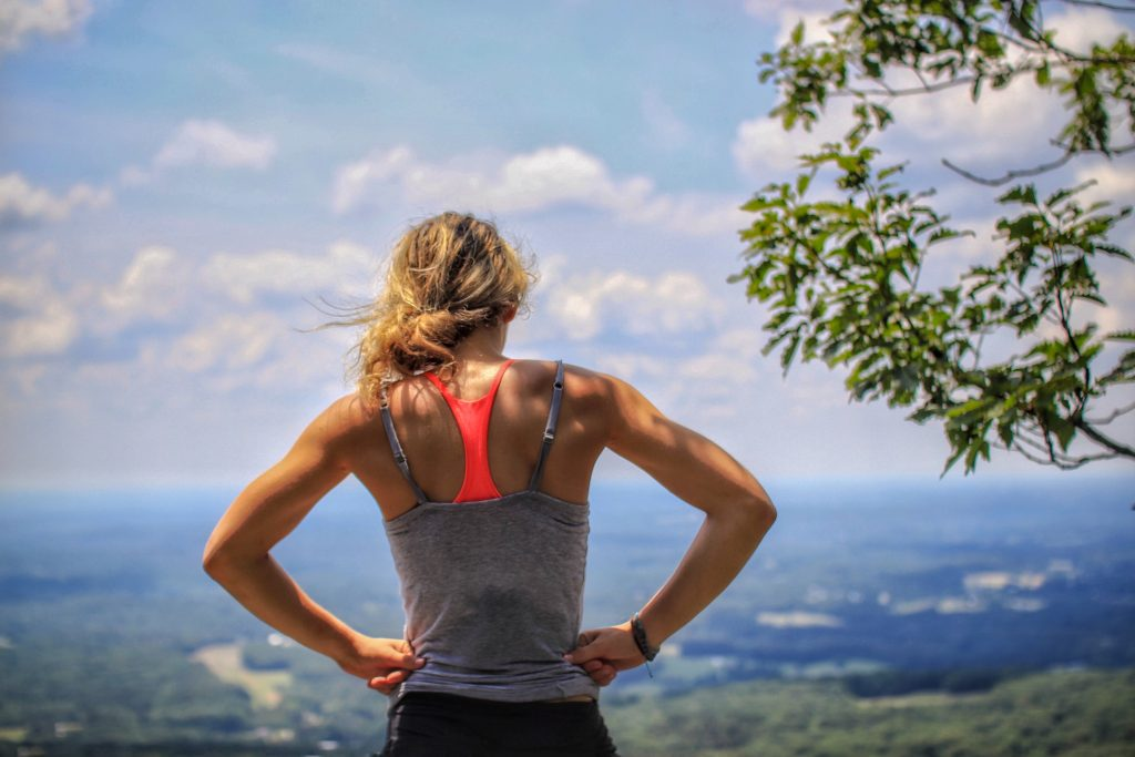 18-Fun-Workouts-to-Get-You-Unstuck-Motivated-in-Life-a-Woman-Looking-at-the-Valley