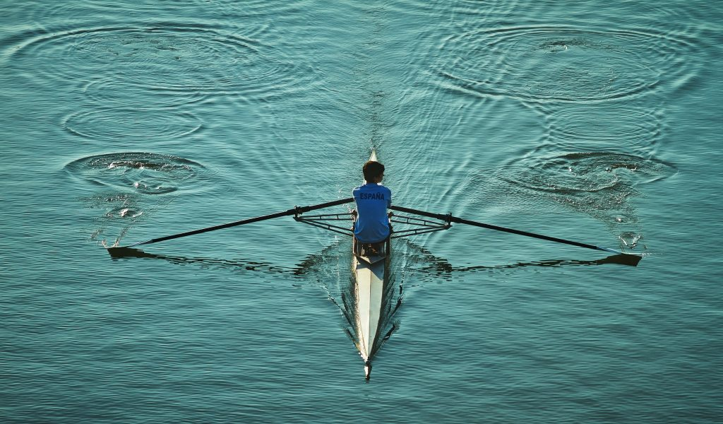 18-Fun-Workouts-to-Get-You-Unstuck-Motivated-in-Lifea-a-Man-in-a-White-Rowing-Boat