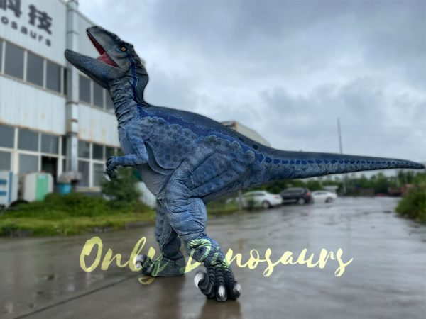 A Blue Raptor on the Ground Roaring Toward the Sky