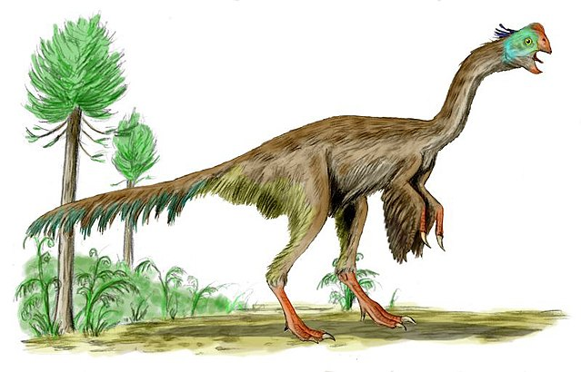 a brown feathered dinosaur with a green beaked head