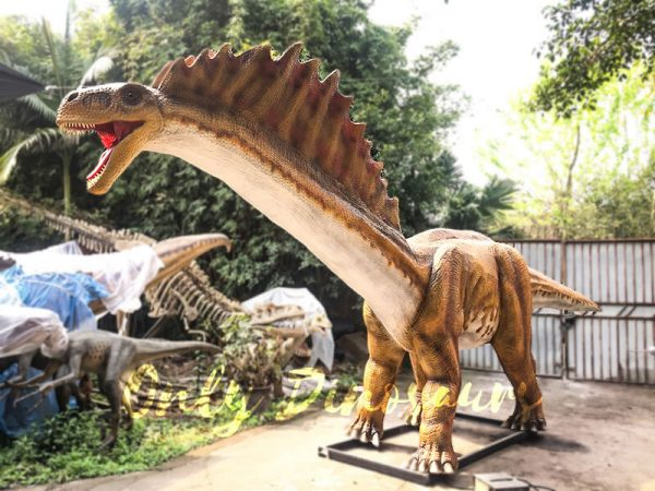a short long-neck brown dinosaur with red spiny projections